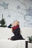pretty woman decorating the Christmas tree