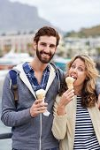 young couple with icecream portrait smiling and having fun