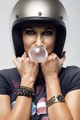 Sexy biker woman is blowing the bubble