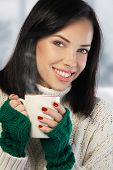 Young Woman Enjoying A Cup Of Coffee