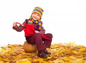 girl with umbrella on autumn leaves studio shoot