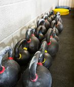 Kettlebells arranged in a row at cross fitness box
