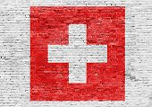 Flag Of Switzerland Over Brick Wall
