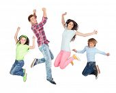 Young happy family jumping isolated on a white background