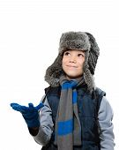 image of headgear  - Winter fur hat clothing boy with outstretched hand and looking up on white background - JPG