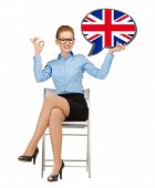 education, foreign language, english, people and communication concept - smiling woman holding text bubble of british flag and showing ok gesture