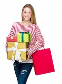 Woman holding shopping bag and gift box