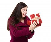 Brunette woman open with gift box