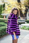Handsome Fashion Model In A Lilac Fur Coat