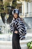 Fashion Model Posing In A Fur Coat And A Fur Hat