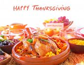 Happy Thanksgiving day, festive table setting with text space, tasty oven baked turkey and vegetables for holiday dinner, decorated with nice little candle