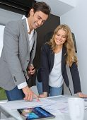 Man and woman in casual business clothes discussing business plan