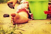 Children's pinches on warm sand