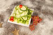 pic of christmas meal  - A Christmas tree salad made with cucumber and cherry tomatoes a healthy kid meal - JPG