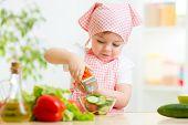 kid girl preparing vegetables