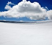 Background of cold winter landscape with snow, blue sky and white cloud - copy space