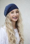 Photo of beautiful young blond girl with braces