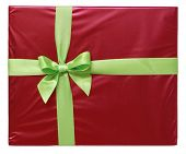 Green ribbon and bow on red gift parcel