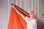 Joking Man Uses Quilt As A Cloak