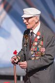 Old veteran of World War II near tribunes