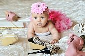 pic of tutu  - baby girl wearing tutu laying on the bed with high heels shoes and bags - JPG