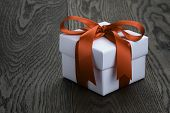 Gift Box With Ribbon Bow On Old Oak Table