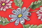 image of applique  - red material with flowers applique  - JPG