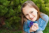 stock photo of pullovers  - Close up portrait of a cute little girl - JPG