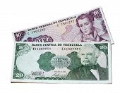 pic of bolivar  - 10 and 20 Venezuelan Bolivares banknotes over a white background - JPG