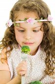 foto of healthy eating girl  - Beautiful healthy little curly girl enjoying eating broccoli isolated on white - JPG