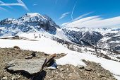 foto of torino  - Majestic wide angle view of snowcapped high mountain peaks in the italian alpine arc in a bright sunny day of spring near  - JPG