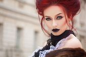 stock photo of gothic hair  - sexy woman with gothic makeup and red hair and castle - JPG