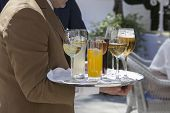 picture of catering  - Professional catering service serving drinks to guests - JPG