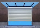 picture of curio  - closed empty news stall on street of city at night time - JPG