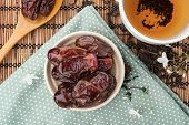 picture of dry fruit  - closeup sweet dried dates fruit with tea - JPG
