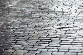 image of cobblestone  - Grey cobblestone road with reflection after rain - JPG