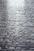 picture of cobblestone  - Dark grey cobblestone road with reflection after rain - JPG