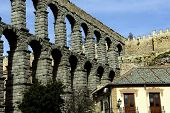 foto of aqueduct  - Ancient Aqueducts in Segovia Spain against a blue sky background - JPG