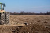 foto of plowed field  - Sowing and plowing action in the spring season