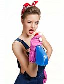 image of pinup girl  - Beautiful cleaning girl wearing pink rubber protective gloves holding spray  - JPG