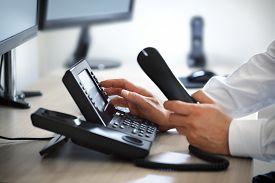 stock photo of liquid  - Dialing telephone keypad concept for communication - JPG