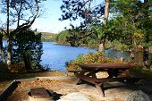 stock photo of backwoods  - the perfect picnic spot alongside a lake in backwoods maine usa - JPG