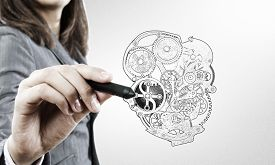 stock photo of mechanical drawing  - Close up of female hand drawing mechanical heart - JPG