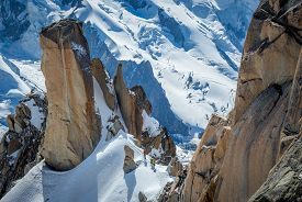 foto of cosmic  - Climbers on dramatic snow covered rocks of Cosmic Ridge, Chamonix, France