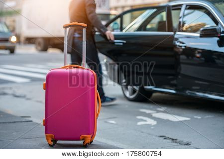 People Taking Taxi From An Airport And Loading Carry On Luggage Bag To The Car