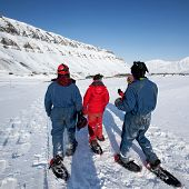 A group of tourists and a guide near Longyearbyen, Svalbard, Norway