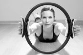 image of saxy  - magic pilates ring woman aerobics sport gym exercises on wooden floor - JPG