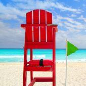 Baywatch red beach seat green wind flag in tropical caribbean sea
