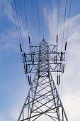 Power pole on blue sky background