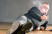Old man smoking wooden pipe